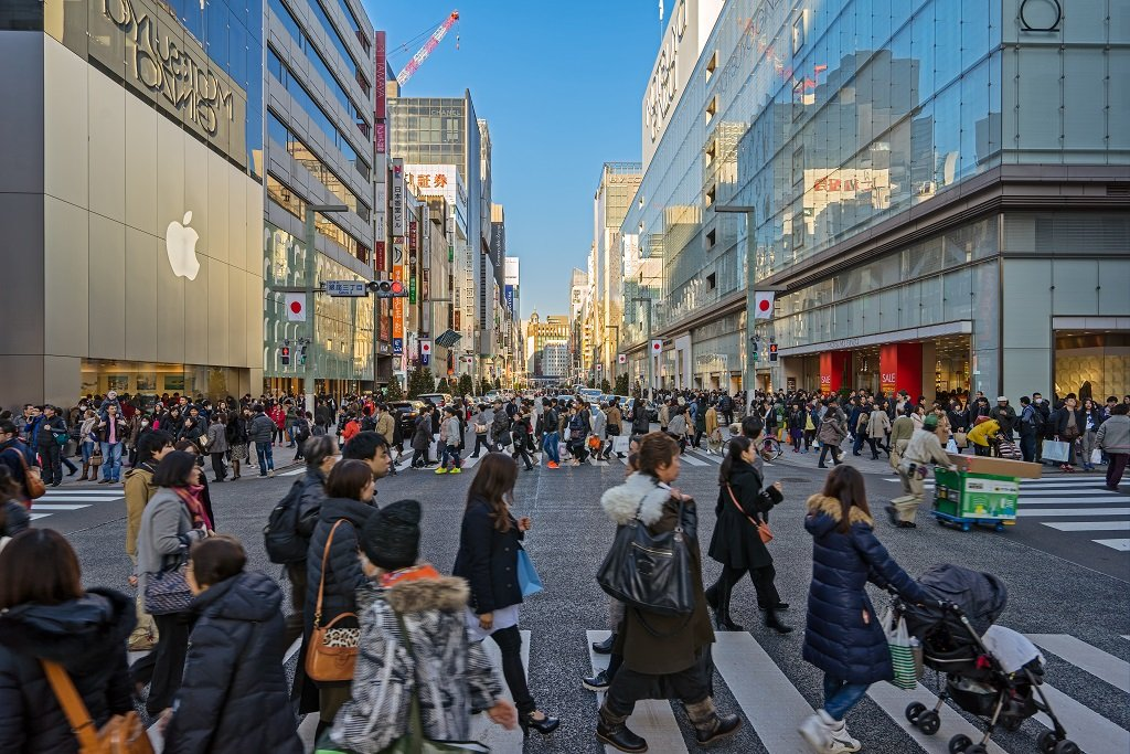 TOKYO, JAPAN - CIRCA JANUARY, 2016: The shopping Ginza district with the famous Chuo Dori that closes to cars on Sundays and becomes a pedestrian street, circa January, 2016 Tokyo.; Shutterstock ID 404430784