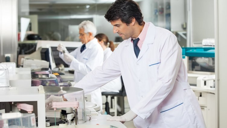 Mid adult male technician experimenting in laboratory using centrifuge; Shutterstock ID 226408627; Departmental Cost Code : 162800; Project Code: GBLMKT; PO Number: GBLMKT; Other: